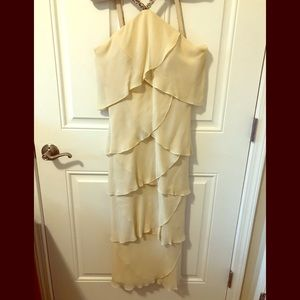 Special occasion dress . Pale yellow , tea length
